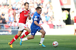 Peterborough United's Paul Taylor in action with Rotherham United's Kari Arnason - Photo mandatory by-line: Joe Dent/JMP - Tel: Mobile: 07966 386802 28/09/2013 - SPORT - FOOTBALL - New York Stadium - Rotherham - Rotherham United V Peterborough United - Sky Bet One
