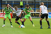 Forest Green Rovers Christian Dioge (9) and Dovers Sam Magri during the Vanarama National League match between Dover Athletic and Forest Green Rovers at Crabble Athletic Ground, Dover, United Kingdom on 10 September 2016. Photo by Shane Healey.