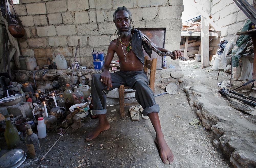 Mondesir Sergo, a voodoo priest in Port-au-Prince sits next to his shrine. Voodoo is part of Haitian culture.