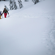 Heather Goodrich and Jilli Morgan skin in the Cascades during a major winter storm whiteout.