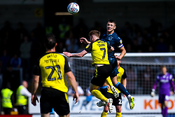 Ollie Clarke of Bristol Rovers heads the ball past Stephen Quinn of Burton Albion - Mandatory by-line: Robbie Stephenson/JMP - 31/08/2019 - FOOTBALL - Pirelli Stadium - Burton upon Trent, England - Burton Albion v Bristol Rovers - Sky Bet League One
