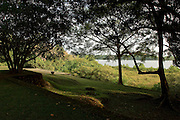 """The Southern slopes.<br /> <br /> LUNUGANGA the country home and & garden of Sri Lanka's most celebrated architect, Geoffrey Bawa...""""Lunuganga, Bentota, 1948-1997....The garden at Lunuganga sits astride two low hills on a promontory which juts out into a brackish lagoon lying off the estuary of the Bentota River.  In 1948, when Bawa first bought it, there was nothing here but an undistinguished bungalow surrounded by ten hectares of rubber plantation.  Since then hills have been moved, terraces have been cut, woods have been replanted and new vistas have been opened up, but the original bungalow still survives within its cocoon of added verandas, courtyards, and loggias."""" from geoffreybawa.com"""