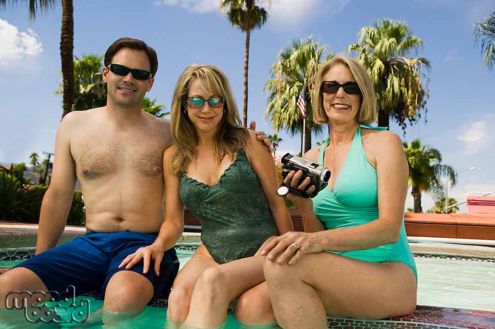 Two Women and a Man at the Pool