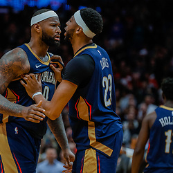 Jan 26, 2018; New Orleans, LA, USA; New Orleans Pelicans center DeMarcus Cousins (0) is held back by forward Anthony Davis (23) during the fourth quarter against the Houston Rockets at the Smoothie King Center. Pelicans defeated the Rockets 115-113. Mandatory Credit: Derick E. Hingle-USA TODAY Sports