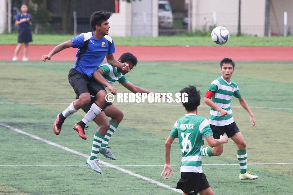 Ayyadarshan (ACJC #14) outbeats Davidson (#12) for the header. (Photo © Chua Kai Yun/Red Sports)