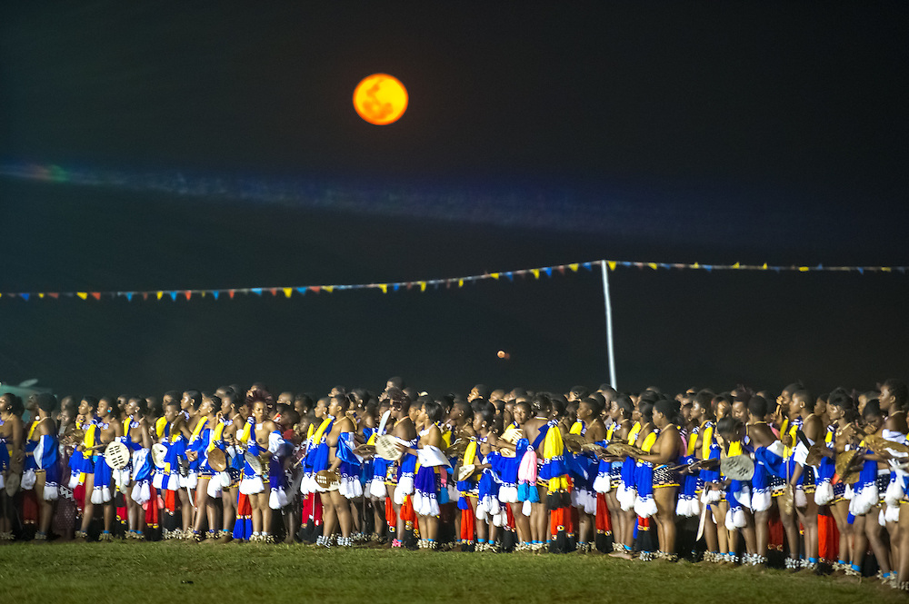 Ludzidzini, Swaziland, Africa - Annual Umhlanga, or reed dance ceremony, in which up to 100,000 young Swazi women gather to celebrate their virginity and honor the queen mother during the 8 day long event.<br /> Maidens dancing under full moon