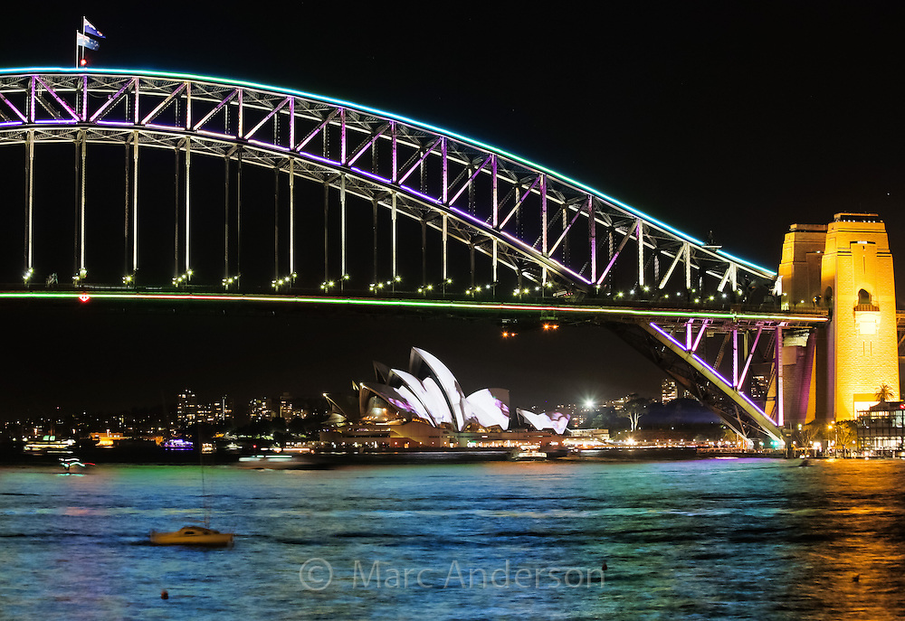 View of the iconic Sydney Harbour Bridge and Sydney Opera House at night during the annual Vivid lighting festival, Sydney, Australia