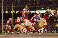 12 January 2013: Quarterback (7) Colin Kaepernick of the San Francisco 49ers passes the ball against the Green Bay Packers during the second half of the 49ers 45-31 victory over the Packers in an NFL Divisional Playoff Game at Candlestick Park in San Francisco, CA.