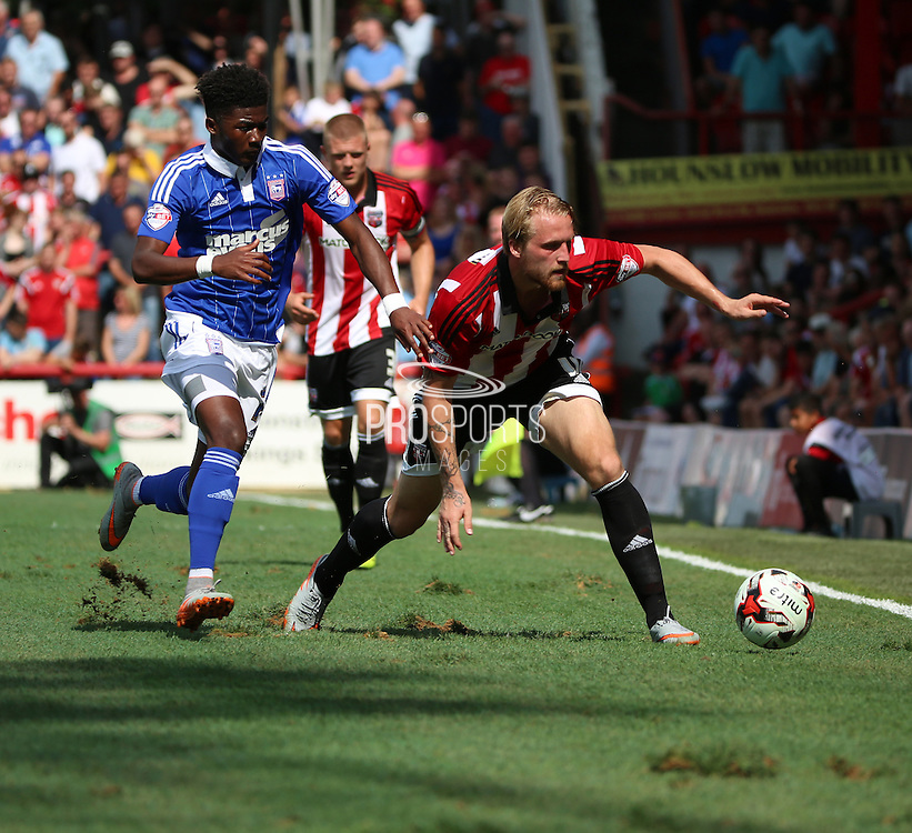 Ainsley Maitland-Niles battling with Konstantin Kerschbaumer on a lumpy pitch during the Sky Bet Championship match between Brentford and Ipswich Town at Griffin Park, London, England on 8 August 2015. Photo by Matthew Redman.