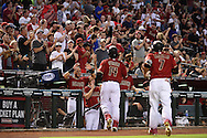 PHOENIX, AZ - JUNE 12:  Peter O'Brien #14 of the Arizona Diamondbacks is congratulated by teammates after hitting a three run home run in the first inning against the Miami Marlins at Chase Field on June 12, 2016 in Phoenix, Arizona.  (Photo by Jennifer Stewart/Getty Images)