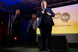 London, UK. 15th January, 2019. Ian Blackford, Leader of the SNP in the House of Commons, sharing the stage with Chuka Umunna, Labour MP for Streatham, and Anna Soubry, Conservative MP for Broxtowe, addresses pro-EU activists attending a People's Vote rally in Parliament Square as MPs vote in the House of Commons on Prime Minister Theresa May's proposed final Brexit withdrawal agreement.