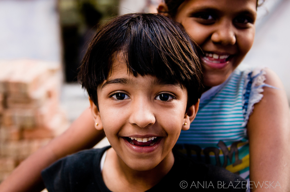 India, Jodhpur. Smiling girls met on one of the Jodhpur streets.