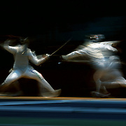 Andrea Baldini, Italy, in action against Ryo Miyake, Japan, in the Men's Foil Individual event during the Fencing competition at ExCel South Hall during the London 2012 Olympic games. London, UK. 31st July 2012. Photo Tim Clayton