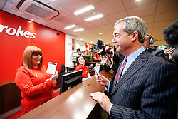 © Licensed to London News Pictures. 02/06/2016. London, UK. UKIP leader NIGEL FARAGE places a £1000 bet on Britain to leave the Eu during a visit to a Ladbrokes betting shop in the City of London on Thursday, 2 June 2016, to campaign for Brexit ahead of the June 23rd EU referendum. Photo credit: Tolga Akmen/LNP