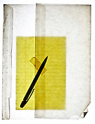 yellow lined notepad paper in translucent envelope with pen