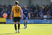 AFC Wimbledon defender Ryan Delaney (21) about to pass the ball forward during the EFL Sky Bet League 1 match between AFC Wimbledon and Bristol Rovers at the Cherry Red Records Stadium, Kingston, England on 21 September 2019.