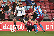 Leon Clarke (9) and Murray Wallace of Scunthorpe United during the Sky Bet League 1 match between Scunthorpe United and Bury at Glanford Park, Scunthorpe, England on 19 April 2016. Photo by Ian Lyall.