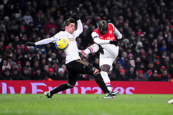 Arsenal's Bacary Sagna shoots - Photo mandatory by-line: Dougie Allward/JMP - Tel: Mobile: 07966 386802 16/01/2013 - SPORT - FOOTBALL - Emirates Stadium - London  -  Arsenal V Swansea City - FA Cup Third-Round replay