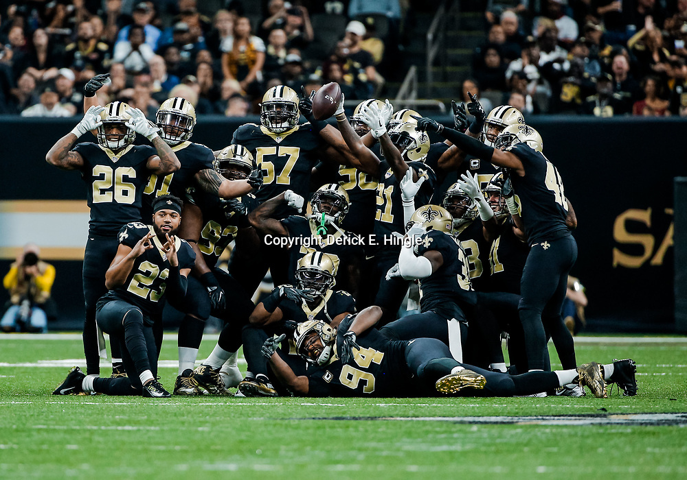 Nov 19, 2017; New Orleans, LA, USA; New Orleans Saints players celebrate following interception by cornerback De'Vante Harris (21) against the Washington Redskins before the play was overturned by a replay review during the second quarter of a game at the Mercedes-Benz Superdome.  Mandatory Credit: Derick E. Hingle-USA TODAY Sports