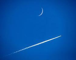 easyJet flight U23033 from London Heathrow to Reykjavik, Iceland, passes the moon in it's Waxing Crescent Phase, 20th January 2018 seen from Alloa, Scotland.
