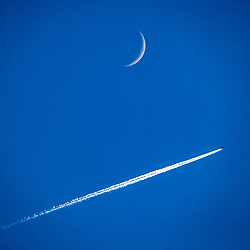 easyJet flight passes the moon in it's Waxing Crescent Phase