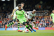 Wolverhampton Wanderers defender Kortney Hause (30) stops a dangerous attack from Fulham striker Sone Aluko (24) during the EFL Sky Bet Championship match between Fulham and Wolverhampton Wanderers at Craven Cottage, London, England on 18 March 2017. Photo by Andy Walter.