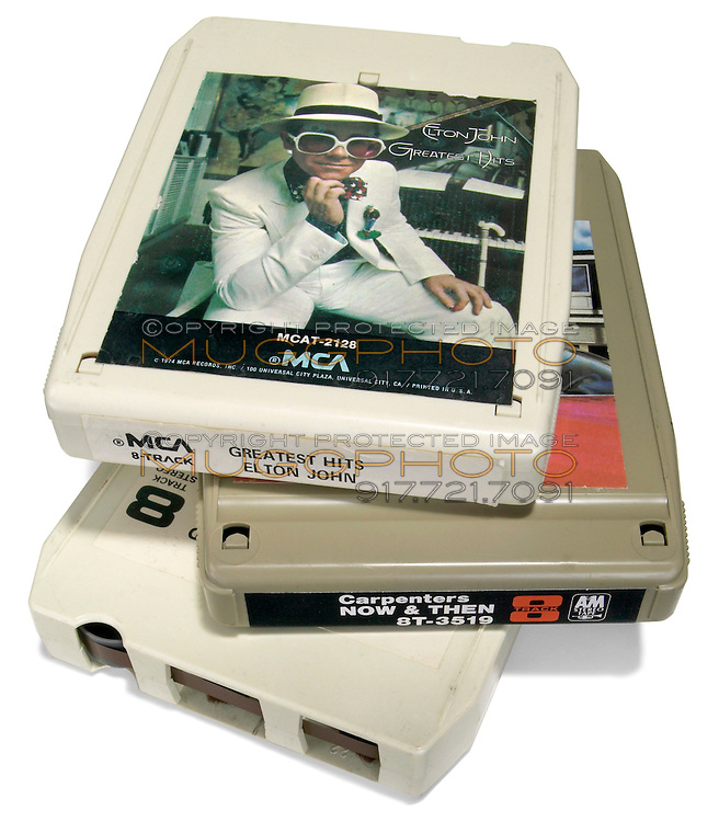 eight track tapes stack topped with elton john greatest hits