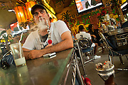 07 JULY 2011 - BANGKOK, THAILAND:  A customer smokes shisha at the Nefertiti Restaurant, an Egyptian restaurant in the Soi Arab neighborhood of Bangkok. Soi Arab started as an alleyway in Bangkok (Soi is the Thai word for alley or small street). What started as an alley has now grown into a neighborhood that encompasses several blocks of restaurants, hotels and money exchanges that cater to Middle Eastern visitors to Thailand. The official name of the street is Sukhumvit Soi 3/1, located in North Nana between Sukhumvit Soi 3 and Sukhumvit Soi 5, not far from the Nana Plaza night-life area and the Grace Hotel popular among Arabs.    PHOTO BY JACK KURTZ