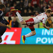 Dax McCarty, New York Red Bulls, is sent flying by a tackle from Jalil Anibaba, Chicago Fire, during the New York Red Bulls V Chicago Fire, Major League Soccer regular season match at Red Bull Arena, Harrison, New Jersey. USA. 27th October 2013. Photo Tim Clayton