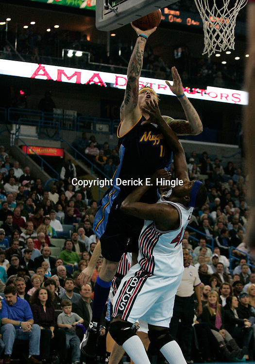 28 January 2009:  Denver Nuggets forward Chris Andersen (11) shoots over New Orleans Hornets forward James Posey (41) during a 94-81 win by the New Orleans Hornets over the Denver Nuggets at the New Orleans Arena in New Orleans, LA. The Hornets wore special throwback uniforms of the former ABA franchise the New Orleans Buccaneers for the game as they honored the Bucs franchise as a part of the NBA's Hardwood Classics series. .