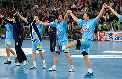 Matjaz Brumen, David Spiler and Uros Zorman of Slovenia celebrate after winning the handball match between National teams of Slovenia and Poland of Qualification Group 3 for Men's EURO 2012, on March 9, 2011 in Arena Stozice, Ljubljana, Slovenia. Slovenia defeated Poland 30-28. (Photo By Vid Ponikvar / Sportida.com)