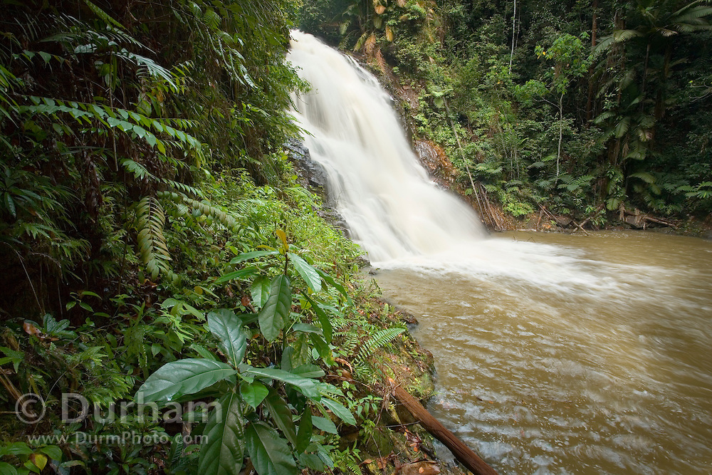 The upper falls of Kota Tinggi Waterfall in Kota Tinggi Forest park, Johore Malayasia. A popular tourist attraction for visitors and locals.