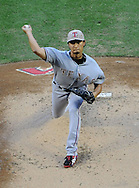 PHOENIX, AZ - MAY 27:  Pitcher Yu Darvish #11 of the Texas Rangers pitches against the Arizona Diamondbacks in the first inning of an interleague game at Chase Field on May 27, 2013 in Phoenix, Arizona.  (Photo by Jennifer Stewart/Getty Images)