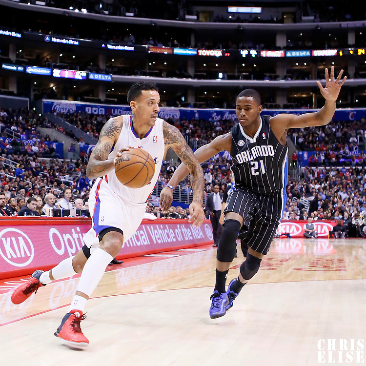 06 January 2014: Los Angeles Clippers small forward Matt Barnes (22) drives past Orlando Magic small forward Maurice Harkless (21) during the Los Angeles Clippers 101-81 victory over the Orlando Magic at the Staples Center, Los Angeles, California, USA.