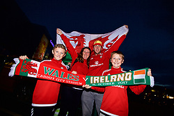 CARDIFF, WALES - Monday, October 9, 2017: A family of Wales supporters outside the stadium before the 2018 FIFA World Cup Qualifying Group D match between Wales and Republic of Ireland at the Cardiff City Stadium. (Pic by Paul Greenwood/Propaganda)