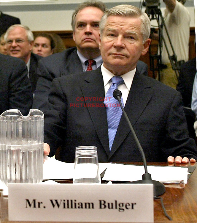 (06/19/03-Washington,DC) UMASS President and former State Senate Prez William Bulger testifies in front of the US Government Reform Committee regarding his knowledge of his mobster brother Whitey. At rear is Robert Connolly and at left is howie CarrCQ)(061903bulgermg-Staff Photo: Mark Garfinkel.saved Sun/adv News)