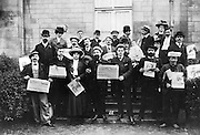 Members of the 'Compagnons du Devoir' or Workers Association of Journeymen of Duty, a form of guild, holding copies of La Guerre Sociale and L'Humanite, communist and antimilitarist newspapers, in 1909, photographer unknown. Copyright © Collection Particuliere Tropmi / Manuel Cohen