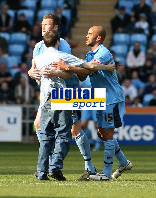 Photo: Mark Stephenson.<br />Coventry City v Queens Park Rangers. Coca Cola Championship. 07/04/2007. Coventry players have to escort a fan from the pitch