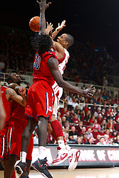 Feb 4, 2012; Stanford CA, USA; Stanford Cardinal forward/center Josh Owens (13) is defended by Arizona Wildcats forward Angelo Chol (30) during the first half at Maples Pavilion.  Arizona defeated Stanford 56-43. Mandatory Credit: Jason O. Watson-US PRESSWIRE