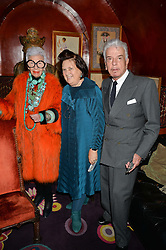 Left to right, IRIS APFEL, SUZI MENKES and NICKY HASLAM at an exclusive dinner for Iris Apfel held at Annabel's, Berkeley Square, London on 29th July 2015.