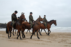 © Licensed to London News Pictures. 20/09/2011. Polzeath, UK. Members of the Royal Artillery exercise their horses in the sea and along the beach at Polzeath Beach, Wadebridge today (20/09/2011). The King's Troop Royal Horse Artillery (known as 'The Troop') are holding their annual summer camp at Polzeath, Cornwall. The unit which is based in St Johns Wood, London is Her Majesty The Queen's ceremonial Saluting Battery. Photo credit: Mark Bowes/LNP