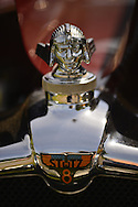 Old Westbury, New York, U.S. - June 1, 2014 - Raa radiator cap hood ornament of a one-of-a-kind 1926 Stutz, Winner of Best in Show for Post War, and owned by STEVEN GITTELMAN of HUNTINGTON, at the Antique and Collectible Auto Show held on the historic grounds of elegant Old Westbury Gardens in Long Island, and sponsored by Greater New York Region AACA Antique Automobile Club of America. This unique car was custom built for Grace and General Cornelius Vanderbilt III, and is the only known one with a Victoria Top.