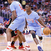 24 November 2013: Los Angeles Clippers point guard Darren Collison (2) drives past Chicago Bulls point guard Marquis Teague (25) on a screen set by Los Angeles Clippers center DeAndre Jordan (6) during the Los Angeles Clippers 121-82 victory over the Chicago Bulls at the Staples Center, Los Angeles, California, USA.