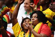 Ghana female fan blowing a whistle