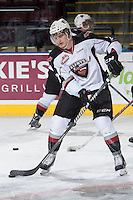 KELOWNA, CANADA - MARCH 15: Jackson Houck #27 of the Vancouver Giants handles the puck during warm up against the Kelowna Rockets on March 15, 2014 at Prospera Place in Kelowna, British Columbia, Canada.   (Photo by Marissa Baecker/Getty Images)  *** Local Caption *** Jackson Houck;