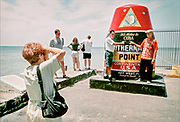 Tourists photographing each other on the southernmost tip of the US. Next stop Cuba. Key West on the southern-most tip of Florida is a popular tourist destination, with a very different vibe to it than Miami.
