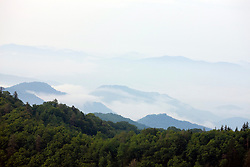 Fog and clouds hover over rolling hills in Great Smoky Mountains National Park, Tennessee, July 8, 2008