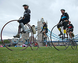 © Licensed to London News Pictures. LONDON, UK  09/06/11. Photo call on Potters Field on the South Bank of the Thames with Penny Farthing riders arriving in London from Saturday's IG Markets London Nocturne cycling event. The riders will all be competing for the Brooks Ordinary Trophy, the Penny Farthing race in Saturday's Nocturne Series Please see special instructions for usage rates. Photo credit should read Matt Cetti-Roberts/LNP