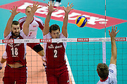 (L) Marcin Mozdzonek and (C) Michal Winiarski both from Poland block against (R) Antonin Rouzier from France during the 2013 CEV VELUX Volleyball European Championship match between Poland and France at Ergo Arena in Gdansk on September 21, 2013.<br /> <br /> Poland, Gdansk, September 21, 2013<br /> <br /> Picture also available in RAW (NEF) or TIFF format on special request.<br /> <br /> For editorial use only. Any commercial or promotional use requires permission.<br /> <br /> Mandatory credit:<br /> Photo by &copy; Adam Nurkiewicz / Mediasport