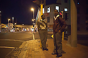 Arafat and Adjmal wait on the mini taxi which takes them to school, pre-dawn in central Cape Town. - Images from the Project South Africa: Working With Nonprofits workshop held in Cape Town, South Africa. Image © Steve Moakley/Momenta Workshops 2013.